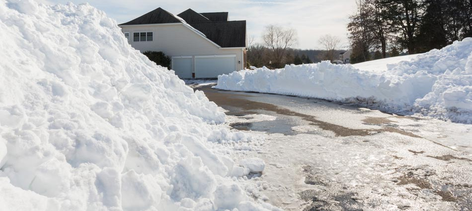 Snow piled on the sides of a driveway after we plowed in Washington, PA.