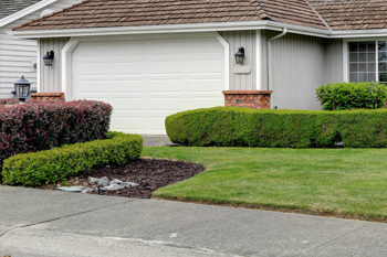 Hedges and shrubs in front of a residential home in Washington, PA.